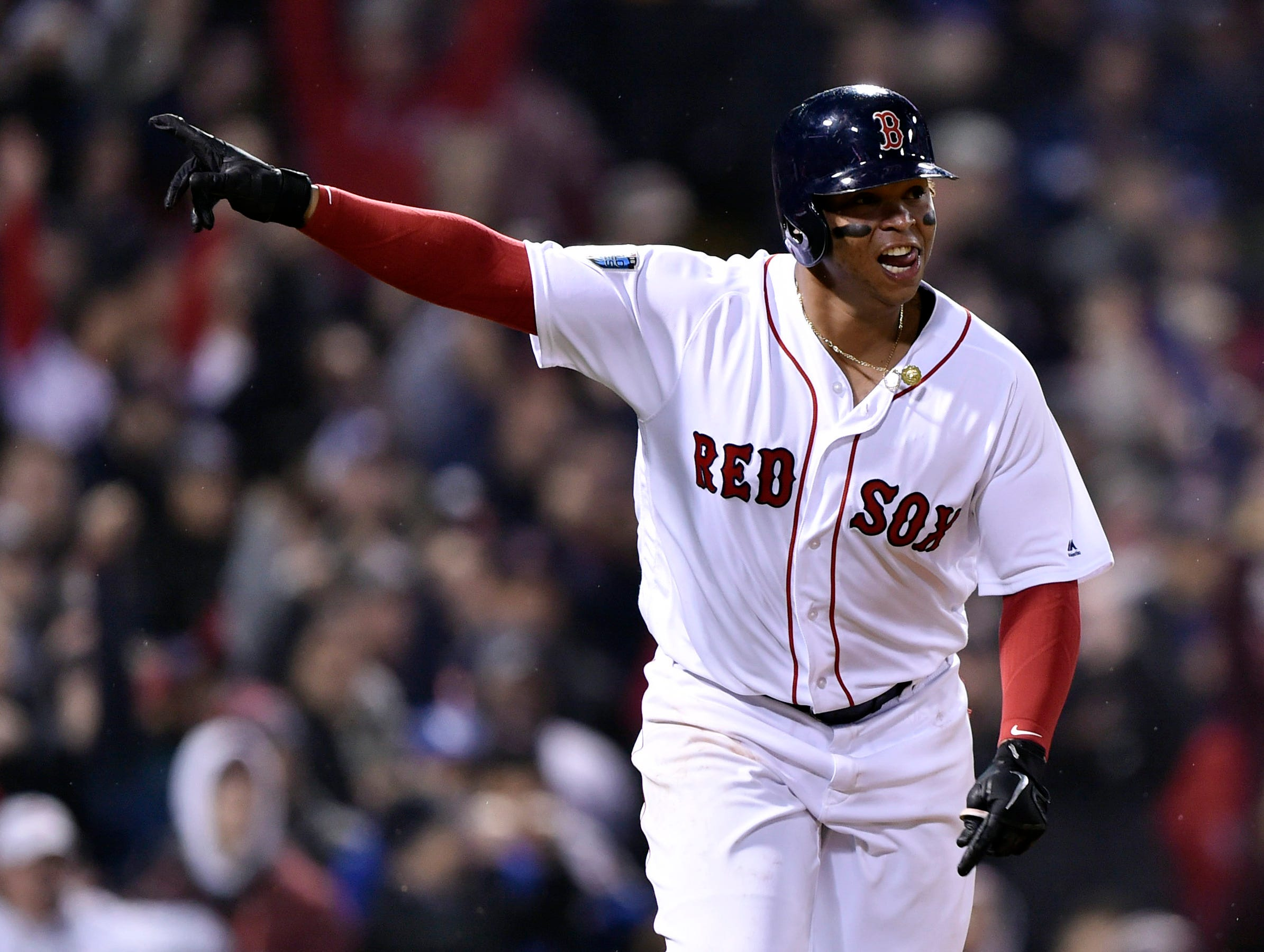 Game 1 at Fenway Park: Rafael Devers celebrates after an RBI single in the fifth.
