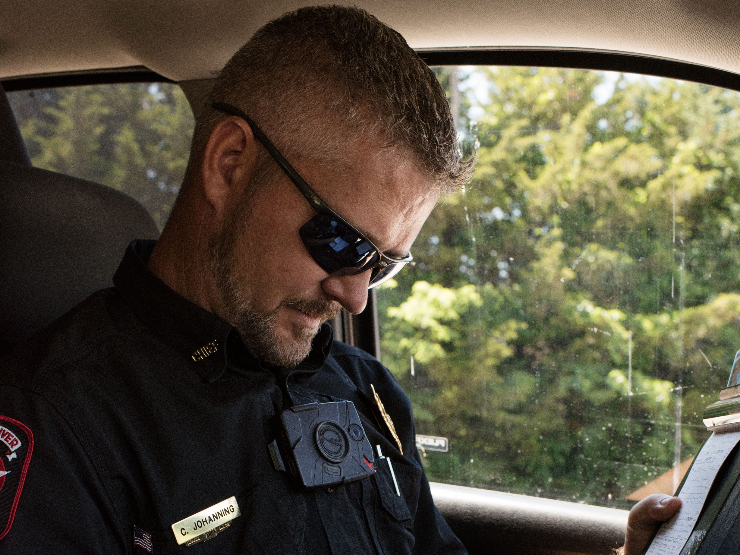 Little River has a low crime rate. As of July, Johanning had only arrested three people this year. Here, he writes a ticket charging a driver with failure to stop at a stop sign.