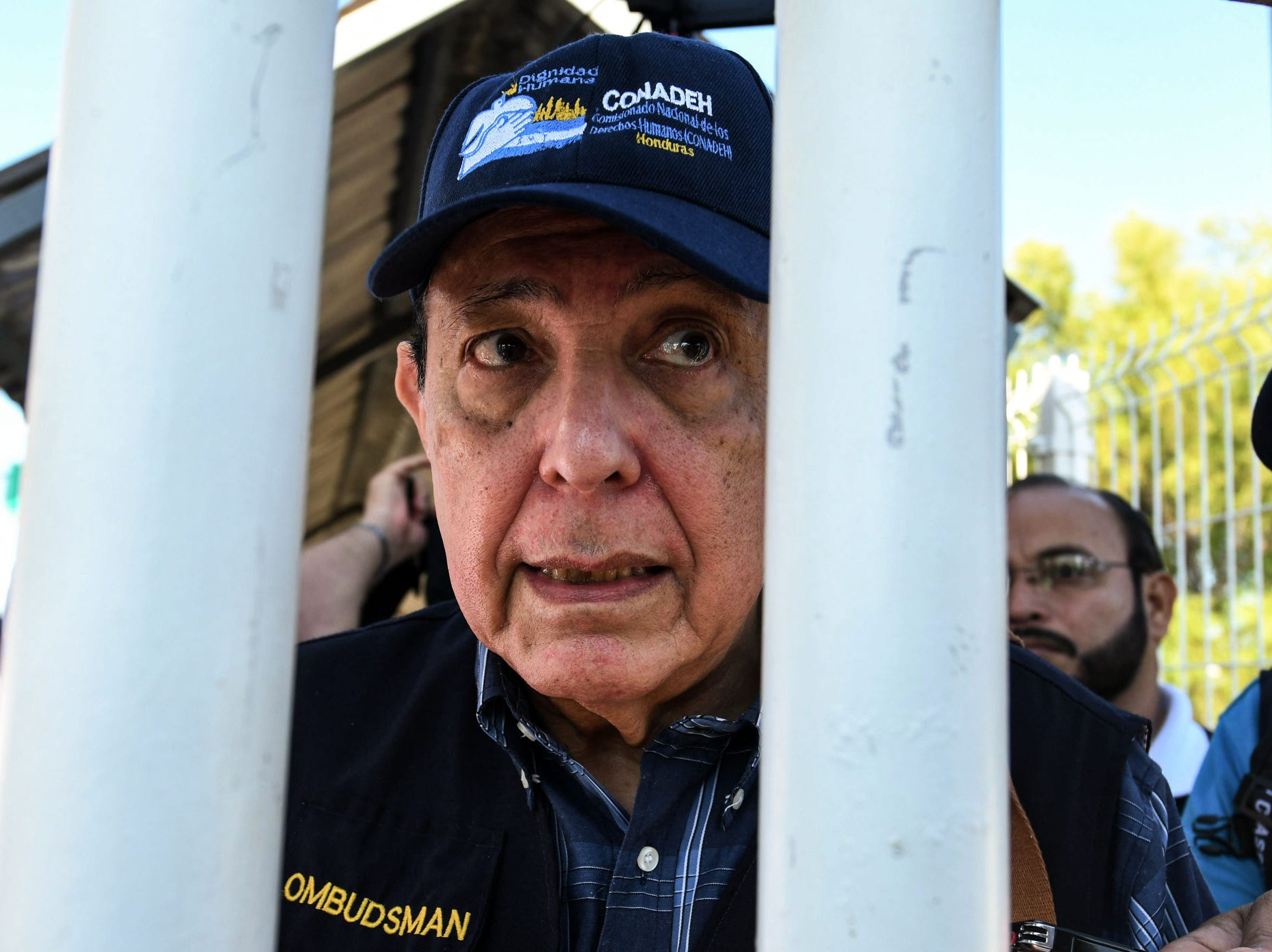 Honduras' Human Rights National Commissioner Roberto Herrera is pictured after being briefed on the situation regarding the recent passage of a massive caravan of Honduran migrants, at the Guatemala-Mexico border bridge, in Ciudad Tecun Uman, Guatemala, on Oct. 23, 2018. Late Monday, Mexico allowed another group of about 400 migrants to enter the country after they spent days packed onto a bridge over the Suchiate River, which forms Mexico's southern border with Guatemala.