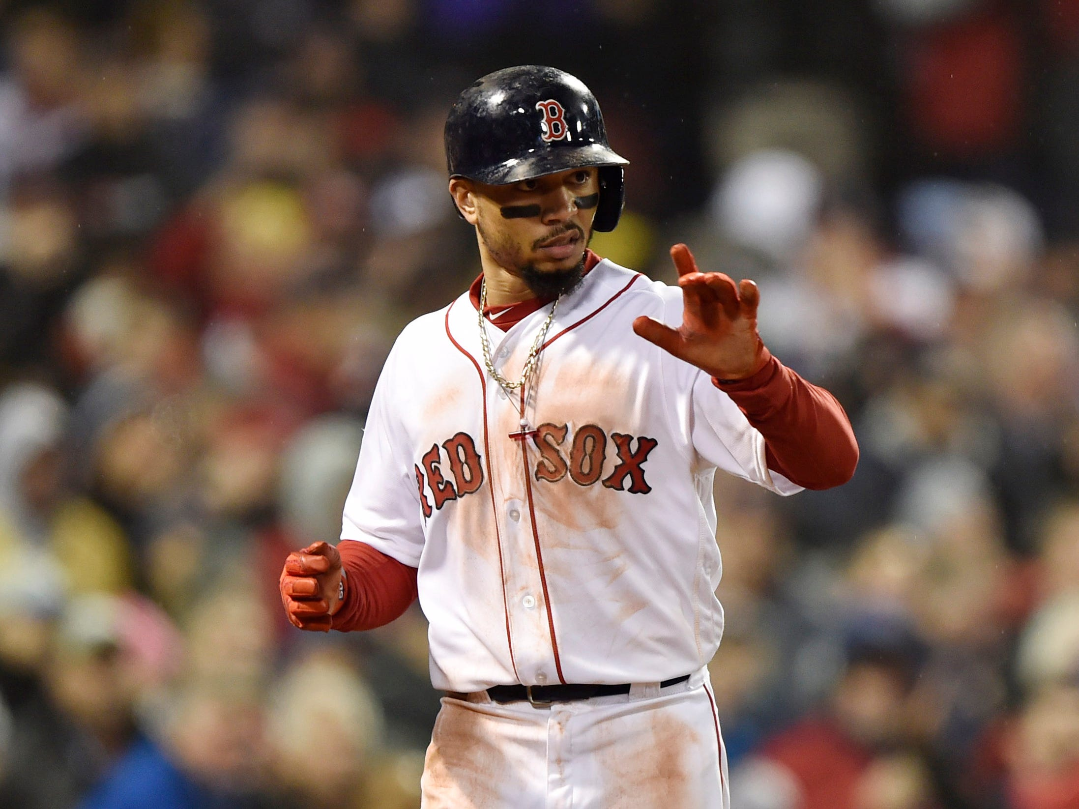 Game 1 at Fenway Park: Mookie Betts reacts after scoring in the fifth.