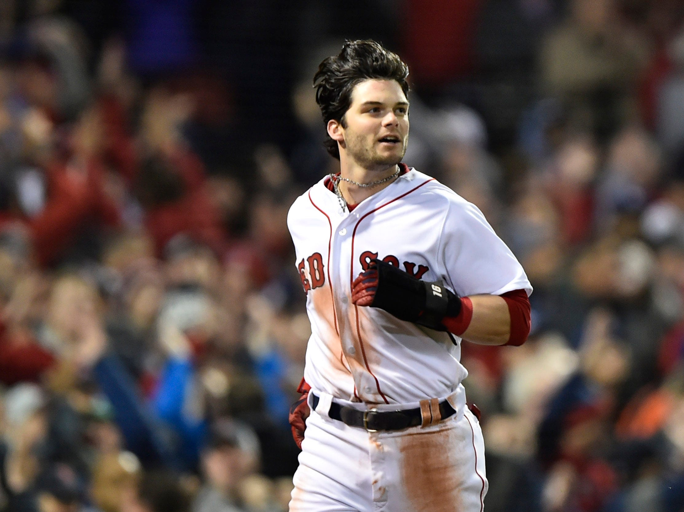 Game 1 at Fenway Park: Andrew Benintendi reacts after scoring a run in the first inning.