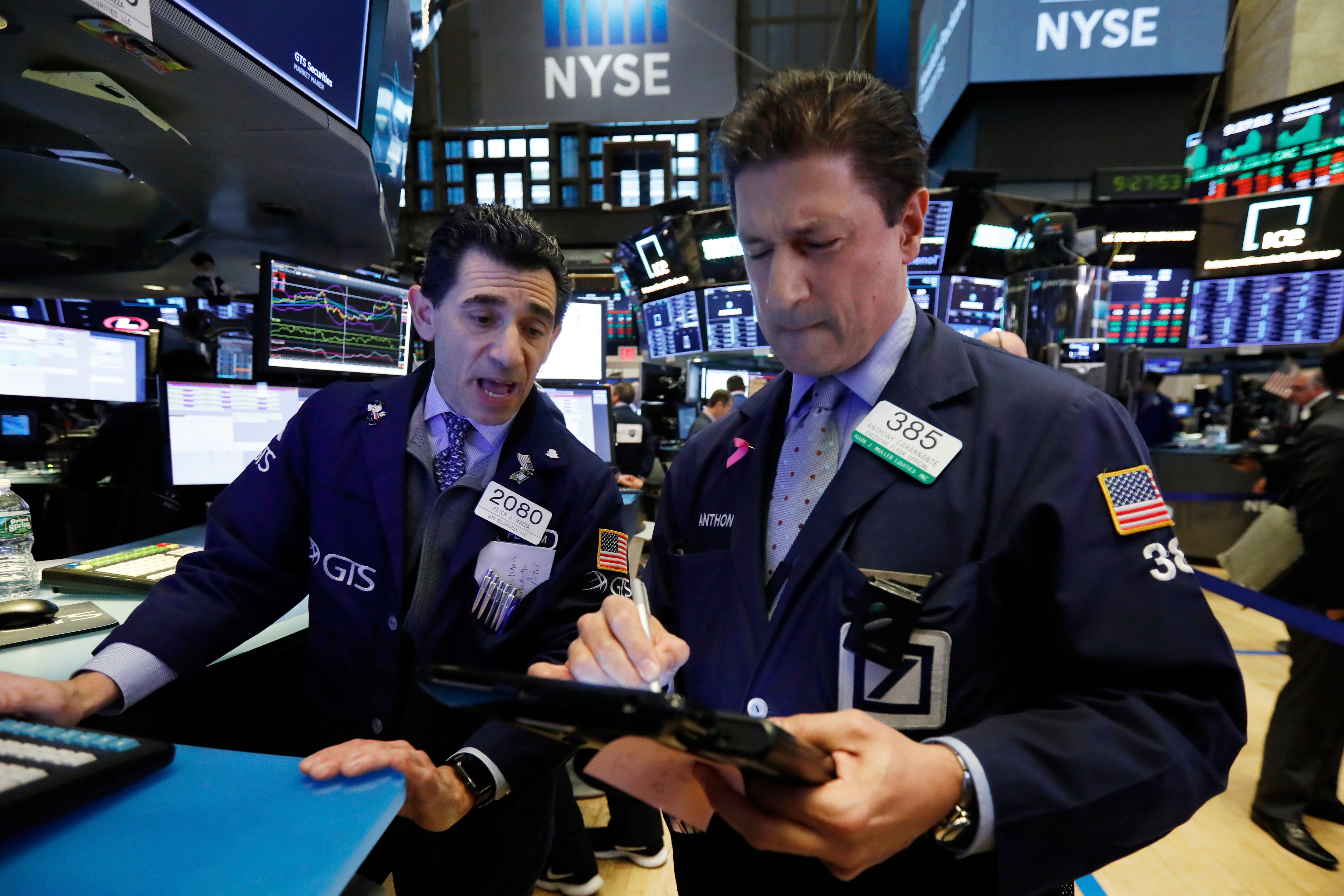 Specialist Peter Mazza, left, and trader Anthony Carannante work on the floor of the New York Stock Exchange on  Wednesday, Oct. 24, 2018. The Dow dropped more than 600 points, and the market now has given back all of this year's gains.