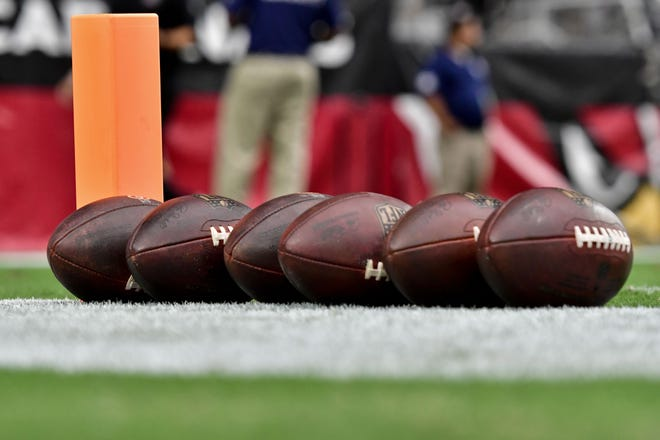 General view of footballs on the field prior to an NFL game at State Farm Stadium in Glendale, Ariz., on Sept. 9.