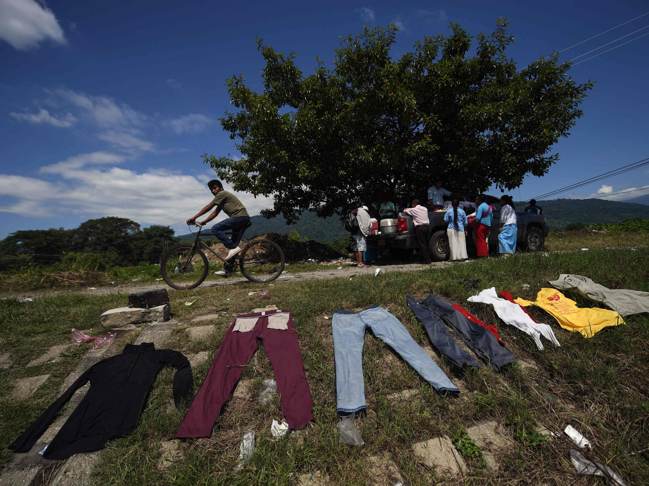 "Clothes dry in the sun by the bank of the Huixtla river, in Huixtla, Chiapas state, Mexico.  Thousands of mainly Honduran migrants head to the United States -- a caravan President Donald Trump has called an ""assault on our country."""