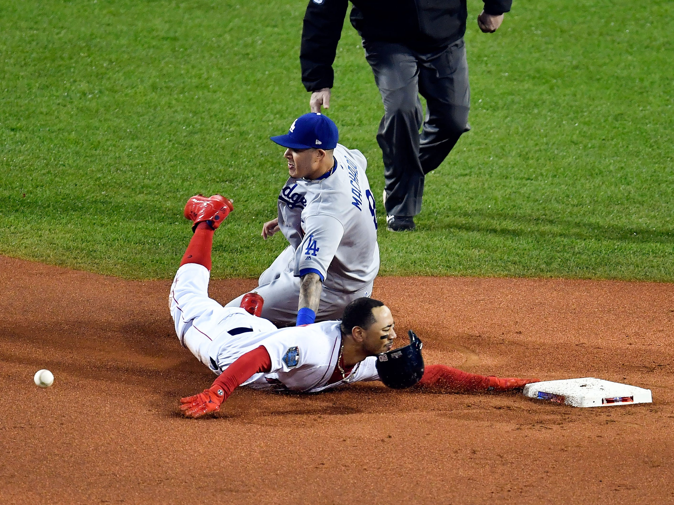 Game 1 at Fenway Park: Mookie Betts slides in safely to steal second base in the first inning.