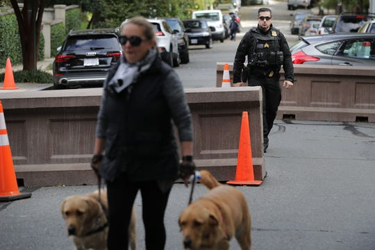 WASHINGTON, DC - OCTOBER 24: A U.S. Secret Service Uniform Division officers patrols along the block where former President Barack Obama and his family live and where an explosive device was sent October 24, 2018 in Washington, DC. The Secret Service said it intercepted the explosive device sent to the Obamas and a similar one that was also sent to former Secretary of State Hillary Clinton and her husband former President Bill Clinton. Another similar explosive device was sent to CNN's offices in New York as well as one sent to billionaire philanthropist George Soros on Monday. (Photo by Chip Somodevilla/Getty Images) ORG XMIT: 775247936 ORIG FILE ID: 1058828896
