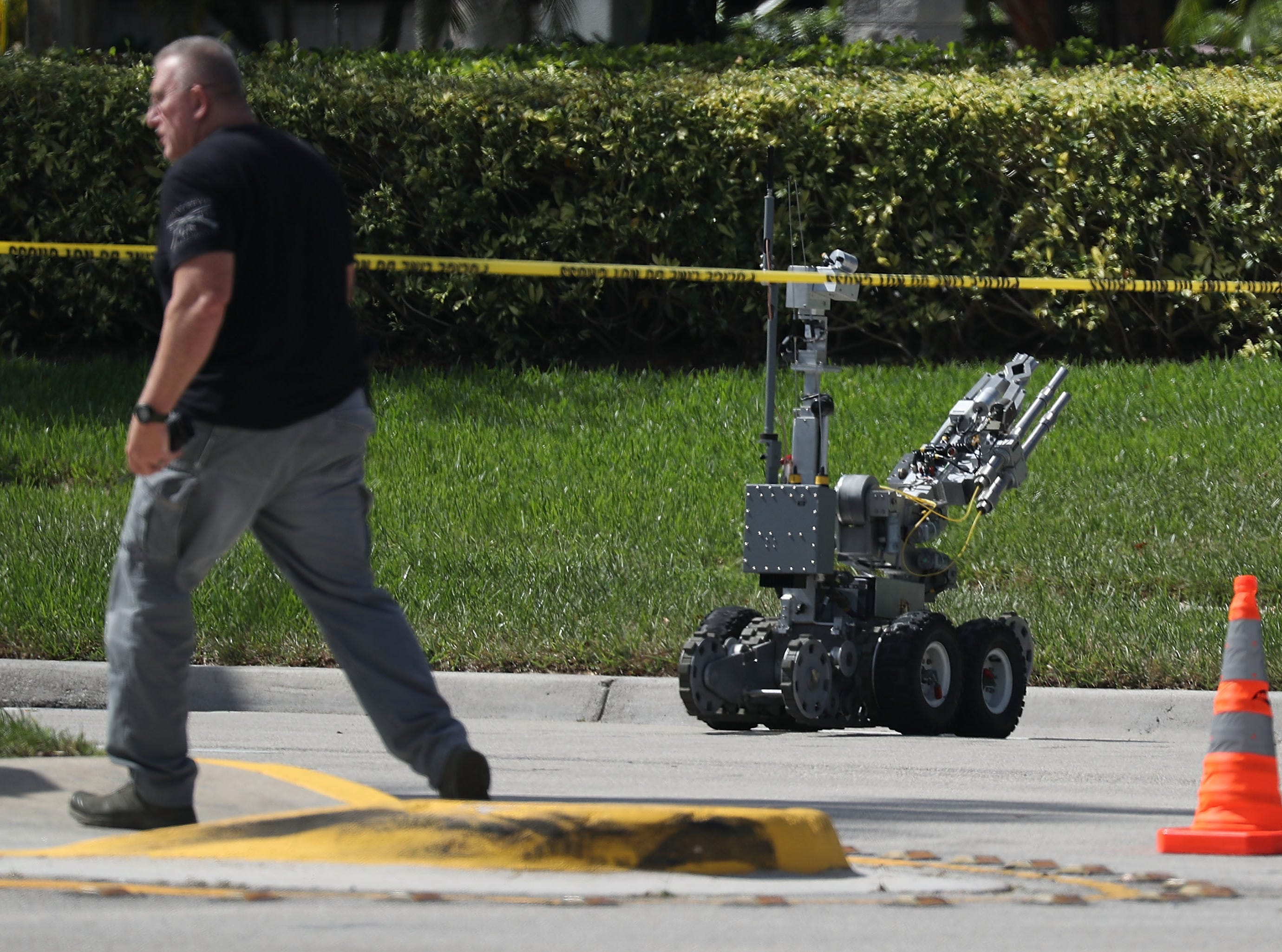 SUNRISE, FL - OCTOBER 24:  The Broward Sheriff's Office bomb squad deploys a robotic vehicle to investigate a suspicious package in the building where Rep. Debbie Wasserman Schultz (D-FL) has an offce on October 24, 2018 in Sunrise, Florida.  A number of suspicious packages arrived in the mail today intended for former President Barack Obama, Democratic presidential nominee Hillary Clinton and the New York office of CNN. (Photo by Joe Raedle/Getty Images) ORG XMIT: 775248002 ORIG FILE ID: 1052941302