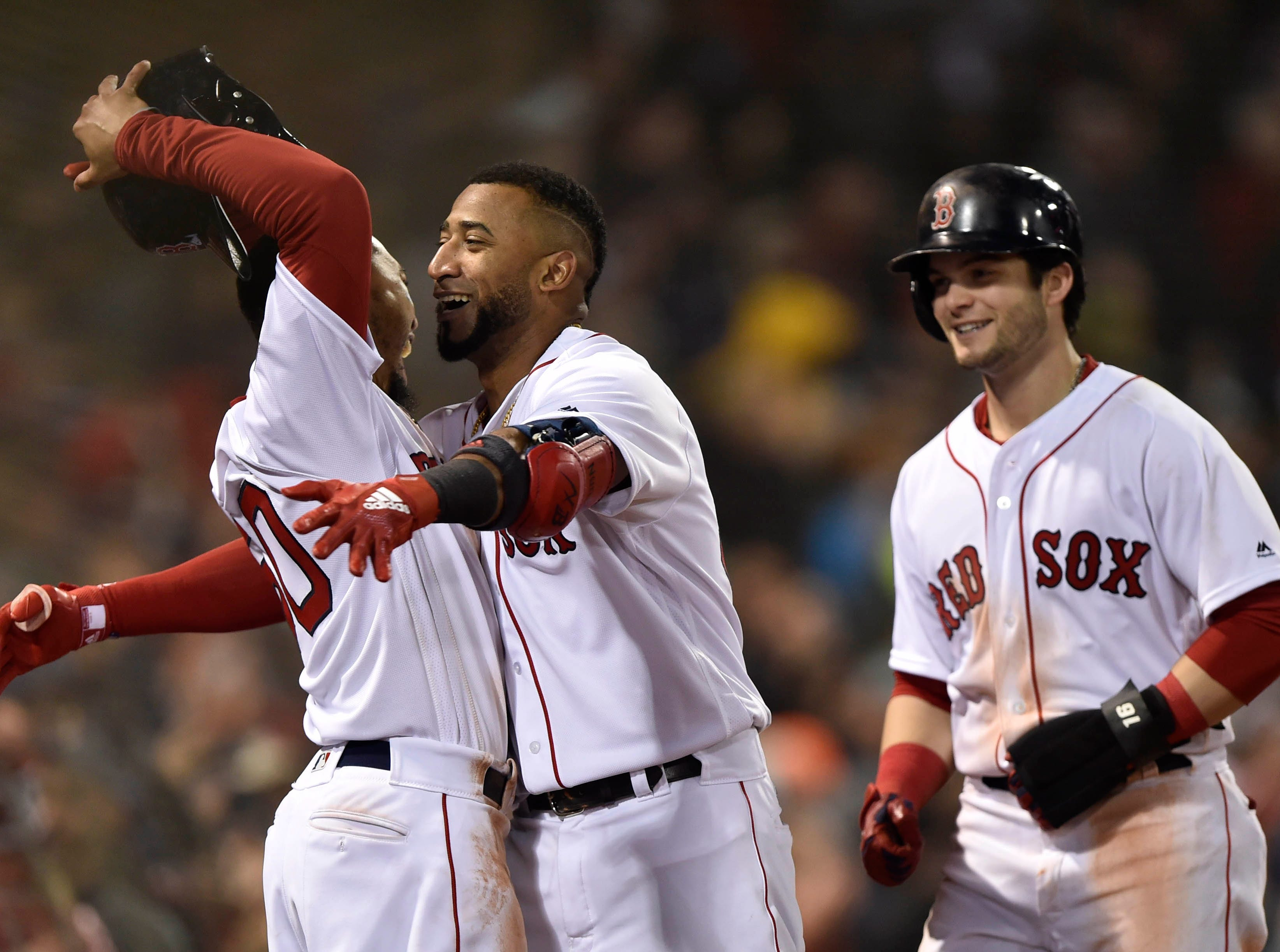 Game 1 at Fenway Park: Eduardo Nunez celebrates with teammates after his three-run homer in the seventh.