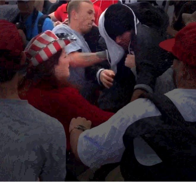 """Member of the white supremacist group, """"Rise Above Movement,"""" Tyler Laube allegedly assaulted a journalist at a March 2017 political rally, the U.S. Attorney's Office said. Laube and three other men, including group founder Robert Rundo, face charges for violence at multiple rallies throughout California in 2017, prosecutors said."""