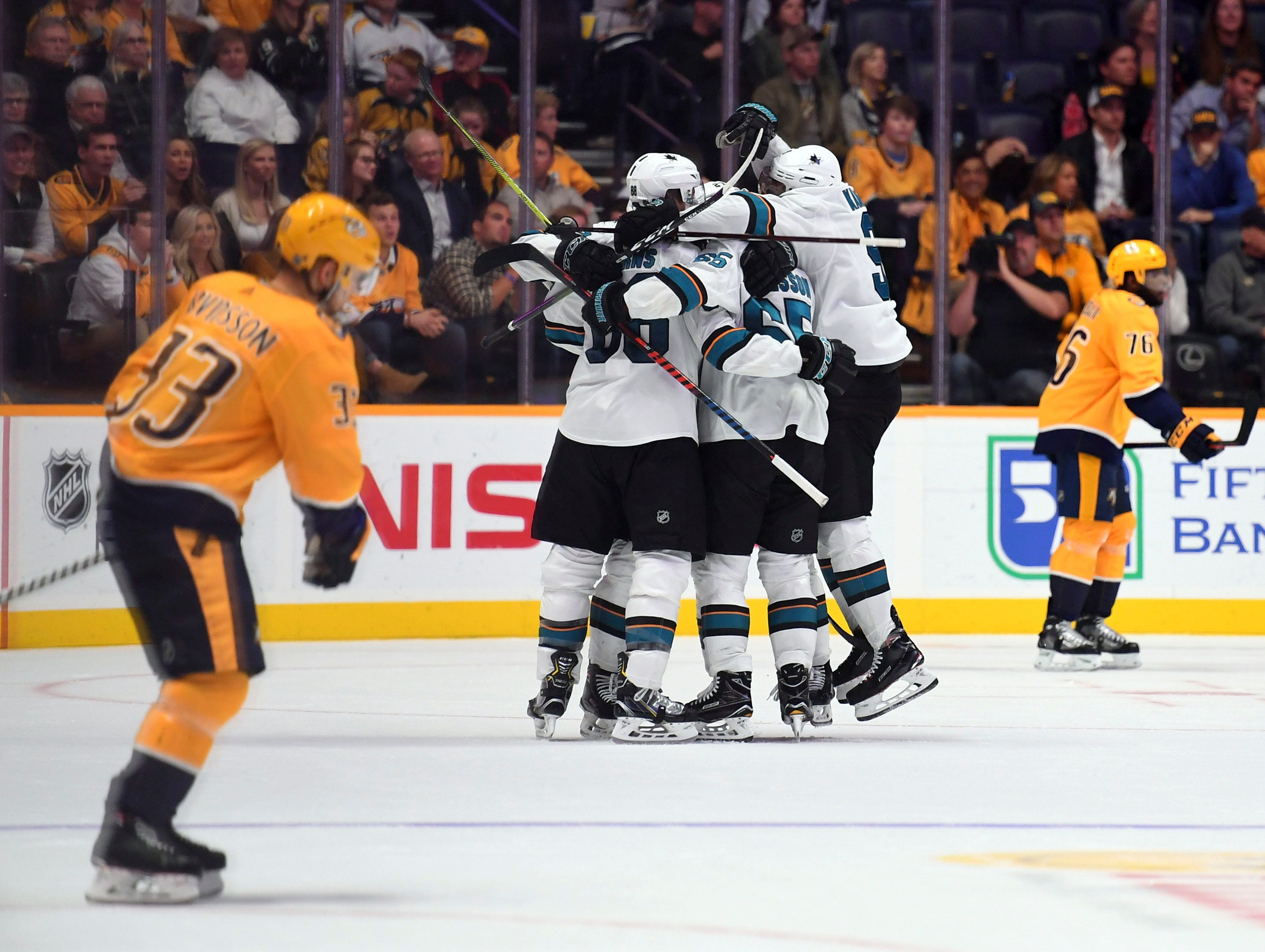 Oct. 23: San Jose Sharks players celebrate after the game-winning goal by defenseman Brent Burns during the third period against the Nashville Predators at Bridgestone Arena.