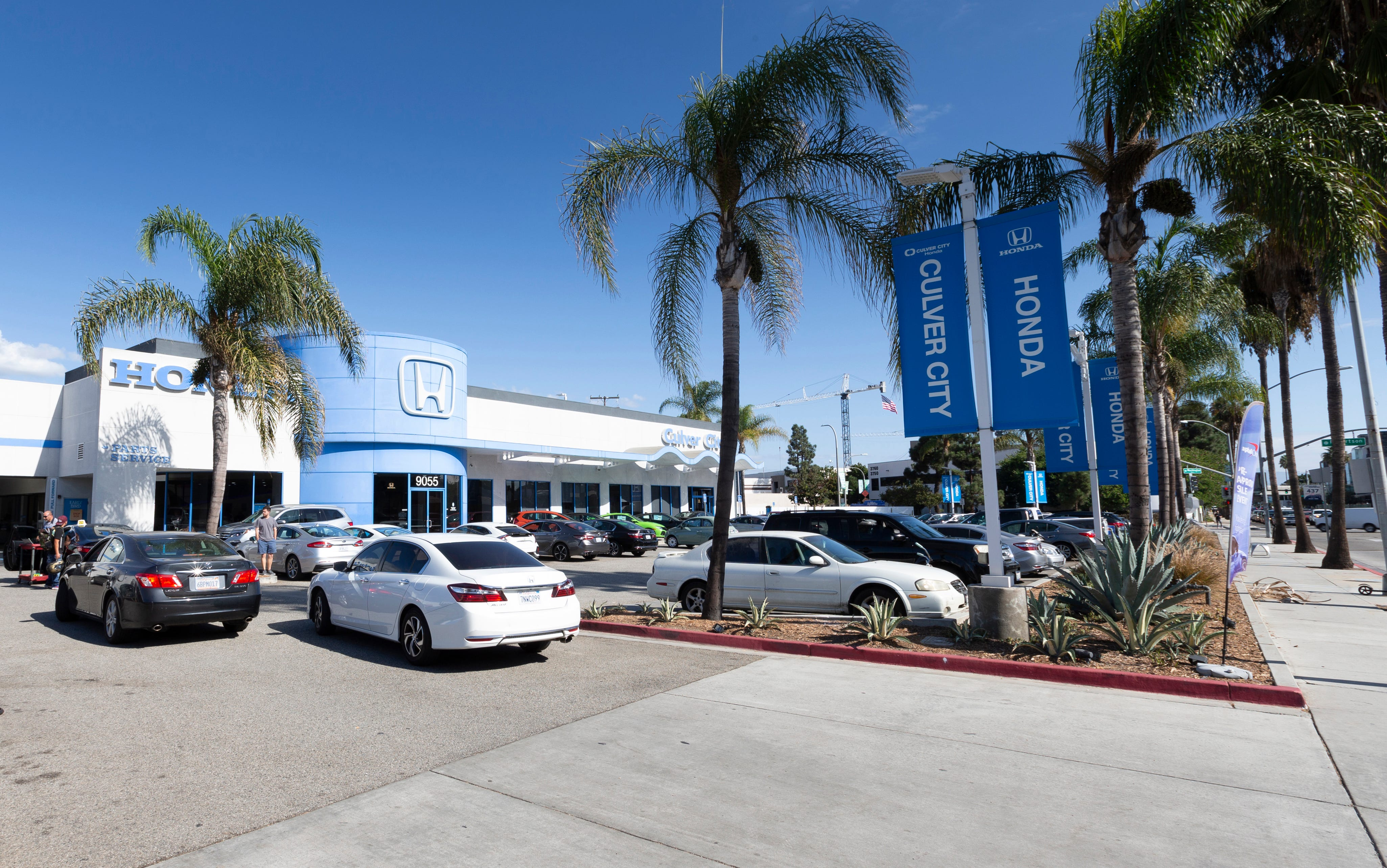 This undated photo provided by Edmunds shows Culver City Honda dealership in Culver City, Calif. First-time buyers are likely to visit dealerships as they shop, but dealership service departments also can be sources of information on vehicle maintenance and repair costs. These are crucial elements in creating a realistic car-buying budget. (Scott Jacobs/Edmunds via AP)