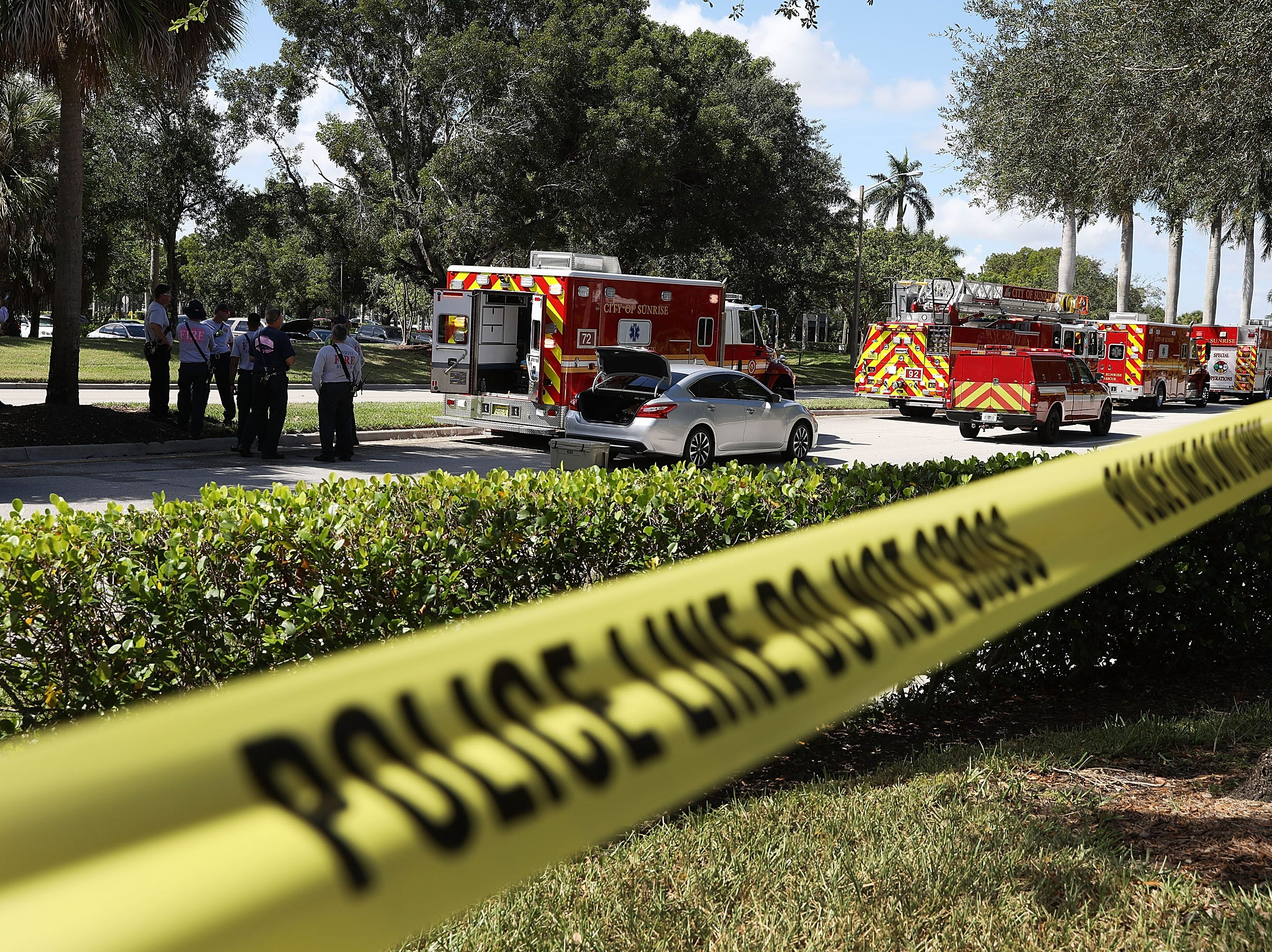 SUNRISE, FL - OCTOBER 24:  Police tape keeps people back as the The Broward Sheriff's Office bomb squad deploys a robotic vehicle to investigate a suspicious package in the building where Rep. Debbie Wasserman Schultz (D-FL) has an offce on October 24, 2018 in Sunrise, Florida.  A number of suspicious packages arrived in the mail today intended for former President Barack Obama, Democratic presidential nominee Hillary Clinton and the New York office of CNN. (Photo by Joe Raedle/Getty Images) ORG XMIT: 775248002 ORIG FILE ID: 1052941258
