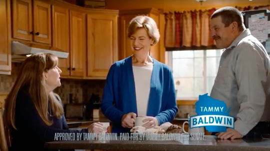 This photo from a television campaign ad provided by the Tammy Baldwin for Senate campaign shows Wisconsin Democratic Sen. Tammy Baldwin, center, talking with Marv and Linda Simcakoski, the parents of a Marine veteran who died at the Tomah Veterans Affairs Medical Center. The spot is one of two ads released Thursday, Sept. 27, 2018, in an attempt by Baldwin to counter one of the main criticisms of her lodged by Republican opponent Leah Vukmir and allied conservative groups. Vukmir has charged that Baldwin failed to respond quickly enough to the crisis at Tomah, where veterans were being over-prescribed opioids.