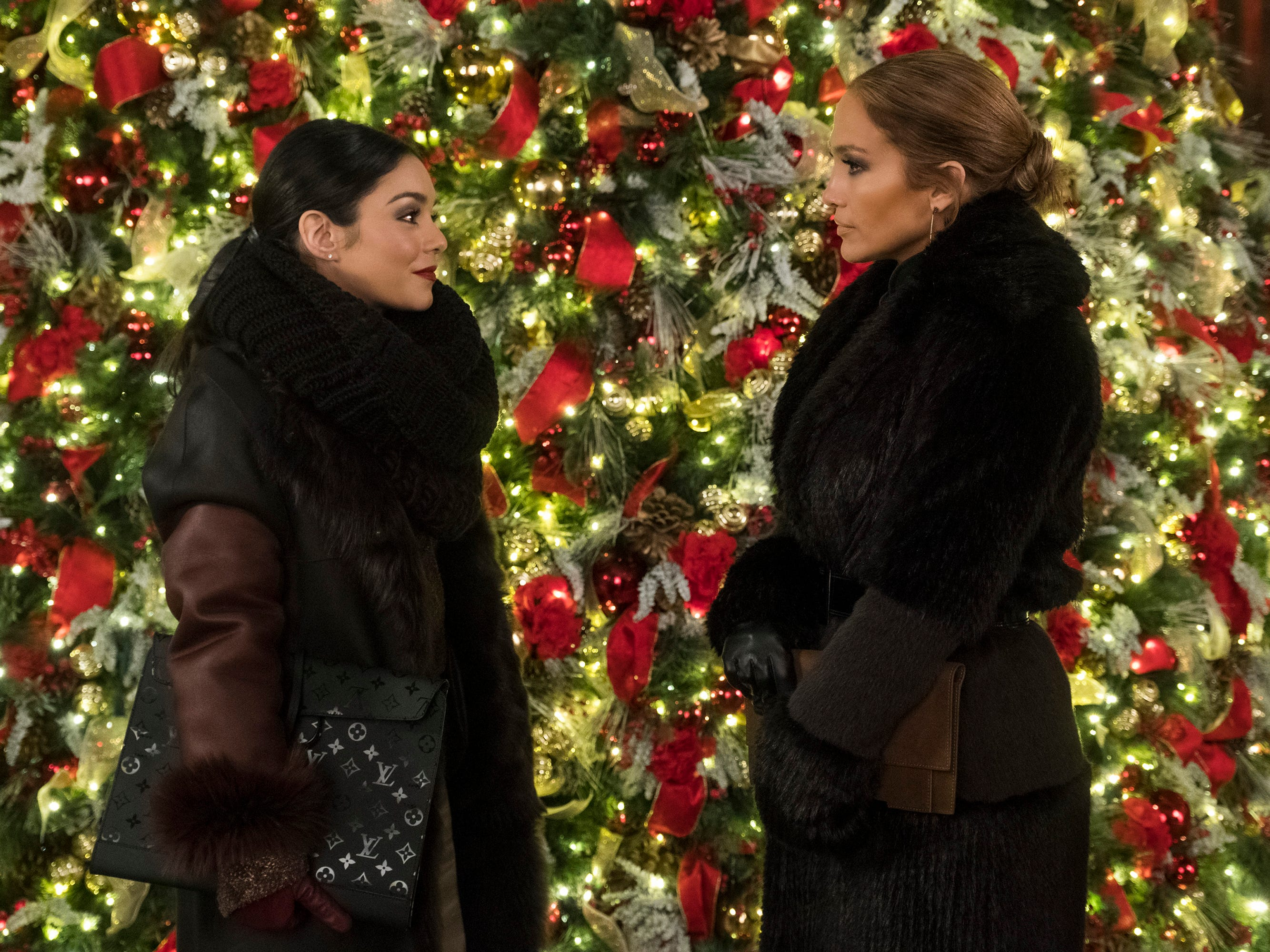 "Jennifer Lopez (right, with Vanessa Hudgens) stars as a low-paid store worker who gets a shot at Madison Avenue success in the comedy ""Second Act."""