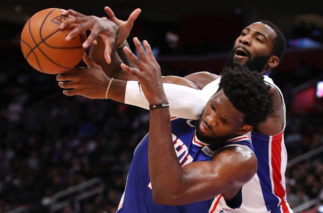 Pistons center Andre Drummond battles for the ball with 76ers center Joel Embiid during the second half at Little Caesars Arena.