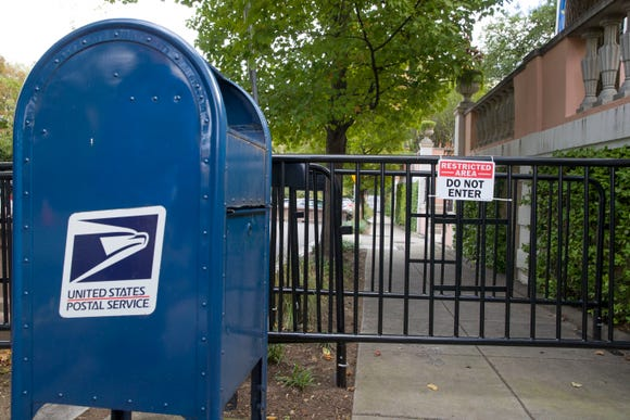 "A U.S. Postal Service mail box is seen at a checkpoint near the home of President Barack Obama, Wednesday, Oct. 24, 2018, in Washington. The U.S. Secret Service says agents have intercepted packages containing ""possible explosive devices"" addressed to former President Barack Obama and Hillary Clinton. (AP Photo/Alex Brandon) ORG XMIT: DCAB107"