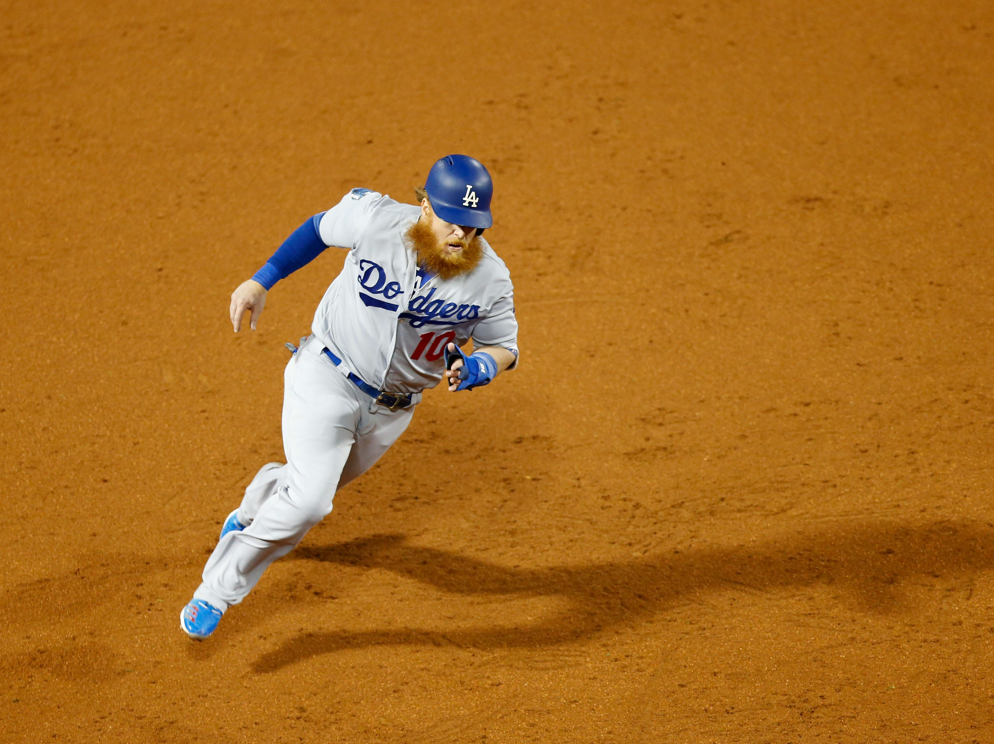Game 1 at Fenway Park: Justin Turner rounds third base to score in the third inning.