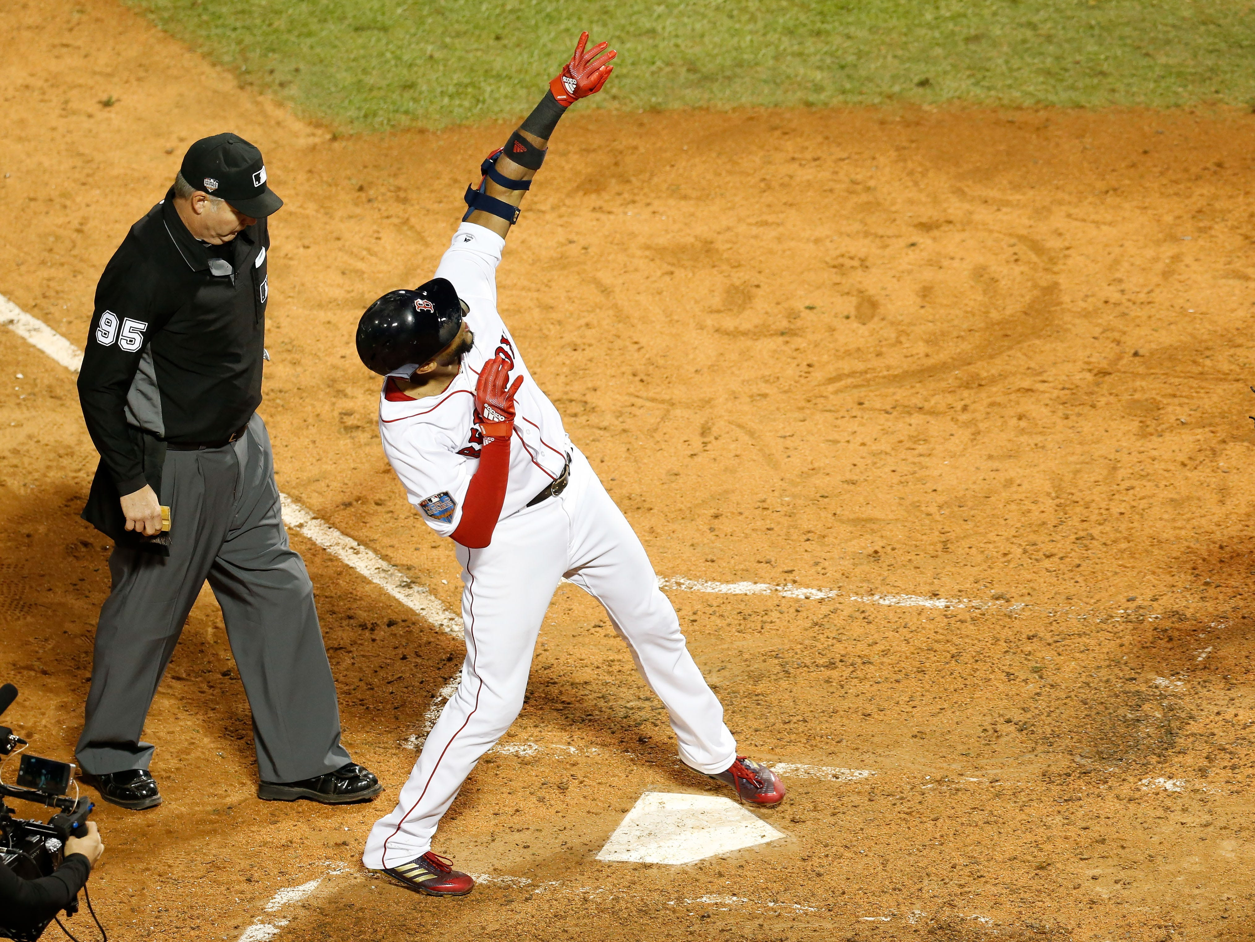 Game 1 at Fenway Park: Eduardo Nunez celebrates his three-run homer in the seventh.