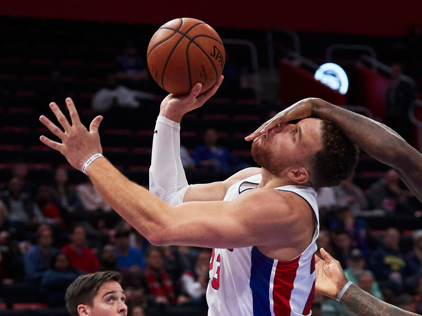 Oct. 23: Pistons forward Blake Griffin takes a hard foul on his way to the hoop during the second half against the 76ers in Detroit.