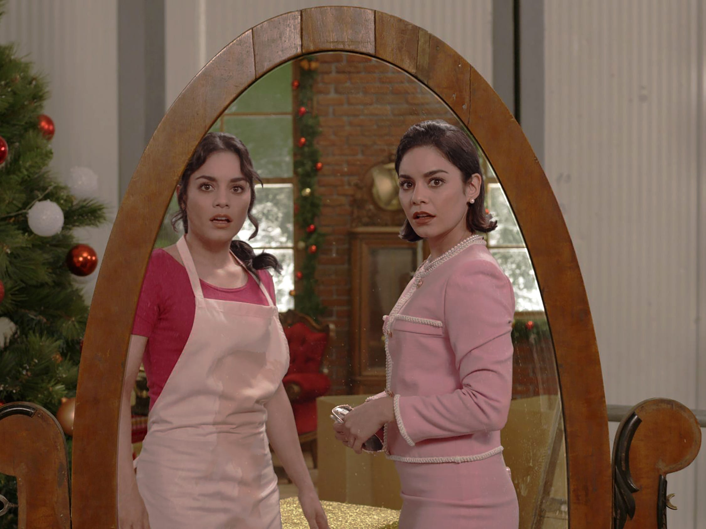 "Margaret (Vanessa Hudgens, right), the Duchess of Montenaro, switches places with lookalike Stacy (Hudgens), a normal woman from Chicago, in the holiday comedy ""The Princess Switch."""