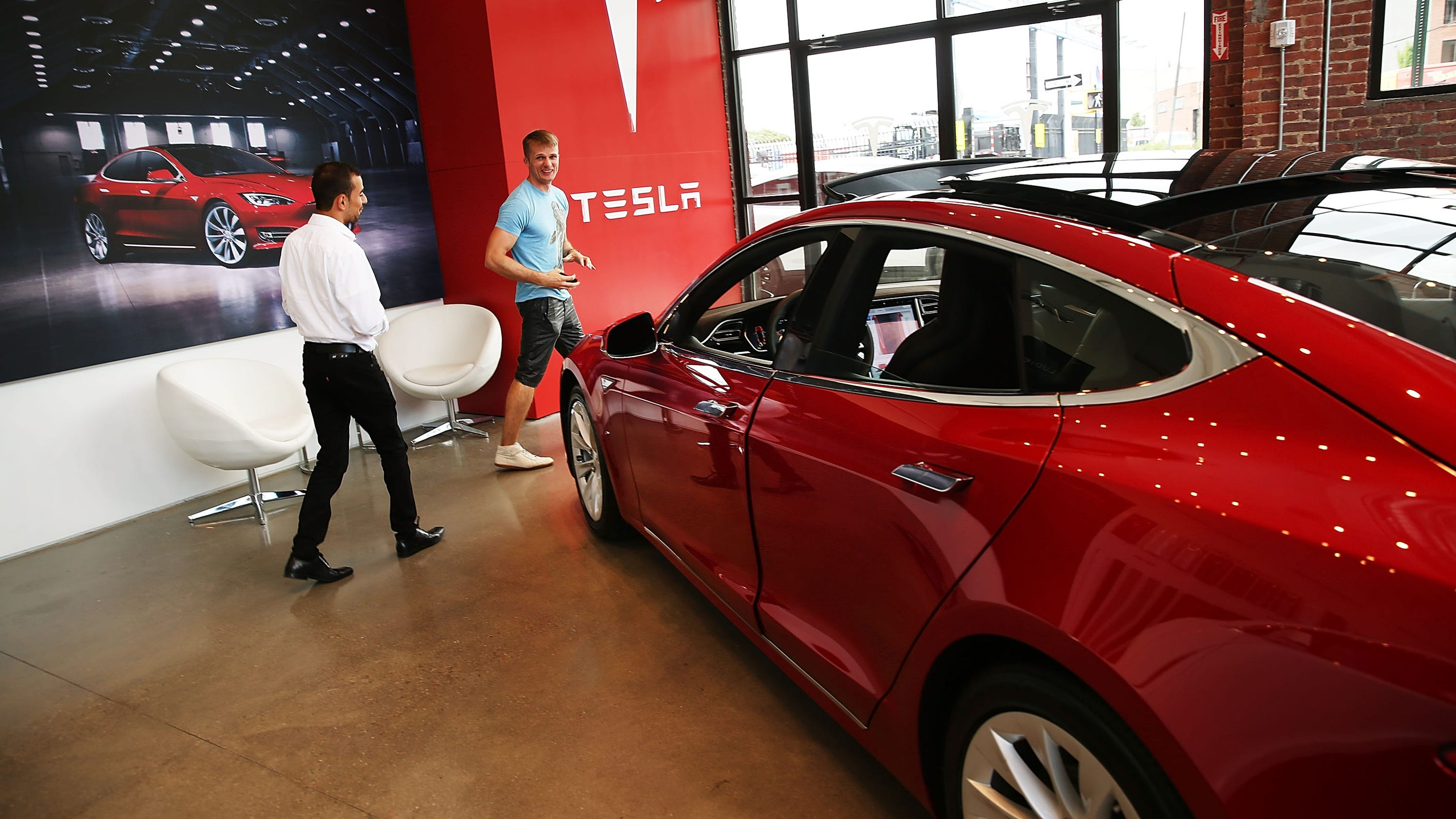 Tesla delivers profit 'many' thought 'impossible,' CEO Elon