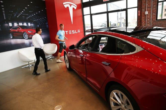 A Tesla Model S sits in a showroom in Brooklyn in July 2016.