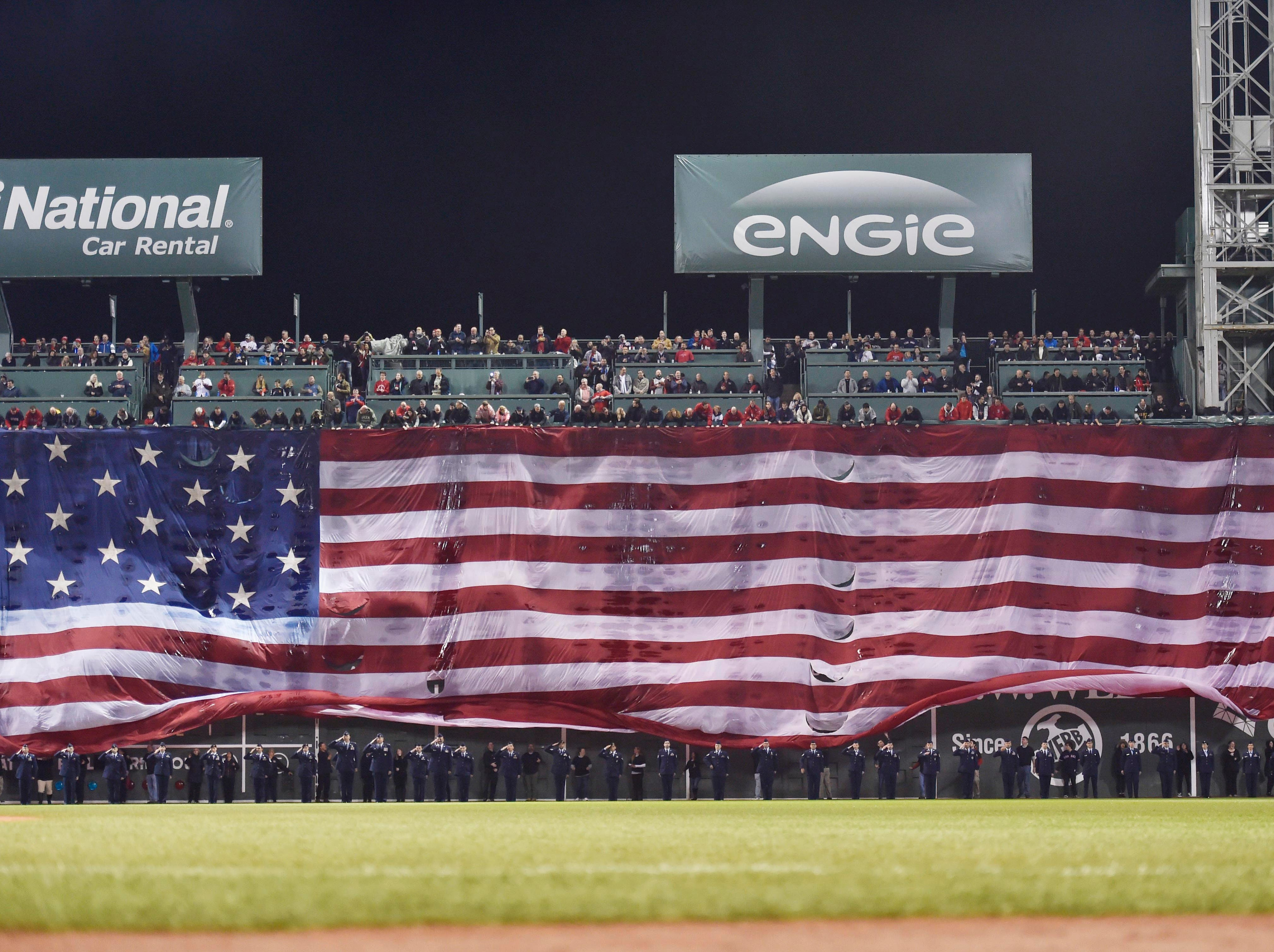 Game 1 at Fenway Park: A giant flag is draped over the Green Monster before the game.