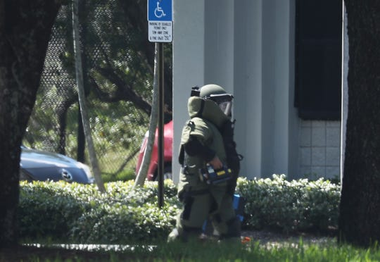 SUNRISE, FL - OCTOBER 24:  A member of the Broward Sheriff's Office bomb squad is seen as he investigates a suspicious package in the building where Rep. Debbie Wasserman Schultz (D-FL) has an office on October 24, 2018 in Sunrise, Florida.  The Secret Service said it intercepted an explosive device sent to former President Barack Obama and a similar one that was also sent to former Secretary of State Hillary Clinton and her husband former President Bill Clinton. Another similar explosive device was sent to CNN's offices in New York as well as one sent to billionaire philanthropist George Soros on Monday. (Photo by Joe Raedle/Getty Images) ORG XMIT: 775248002 ORIG FILE ID: 1052942284