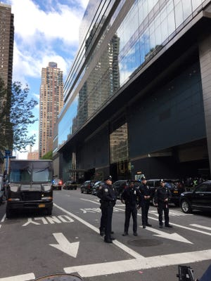 NYPD officers outside Time Warner building in Manhattan on Oct. 24, 2018, where CNN offices are located.  CNN's New York bureau was evacuated and roads were closed off around the Time Warner building after reports of a suspicious packing mailed to CNN's offices.