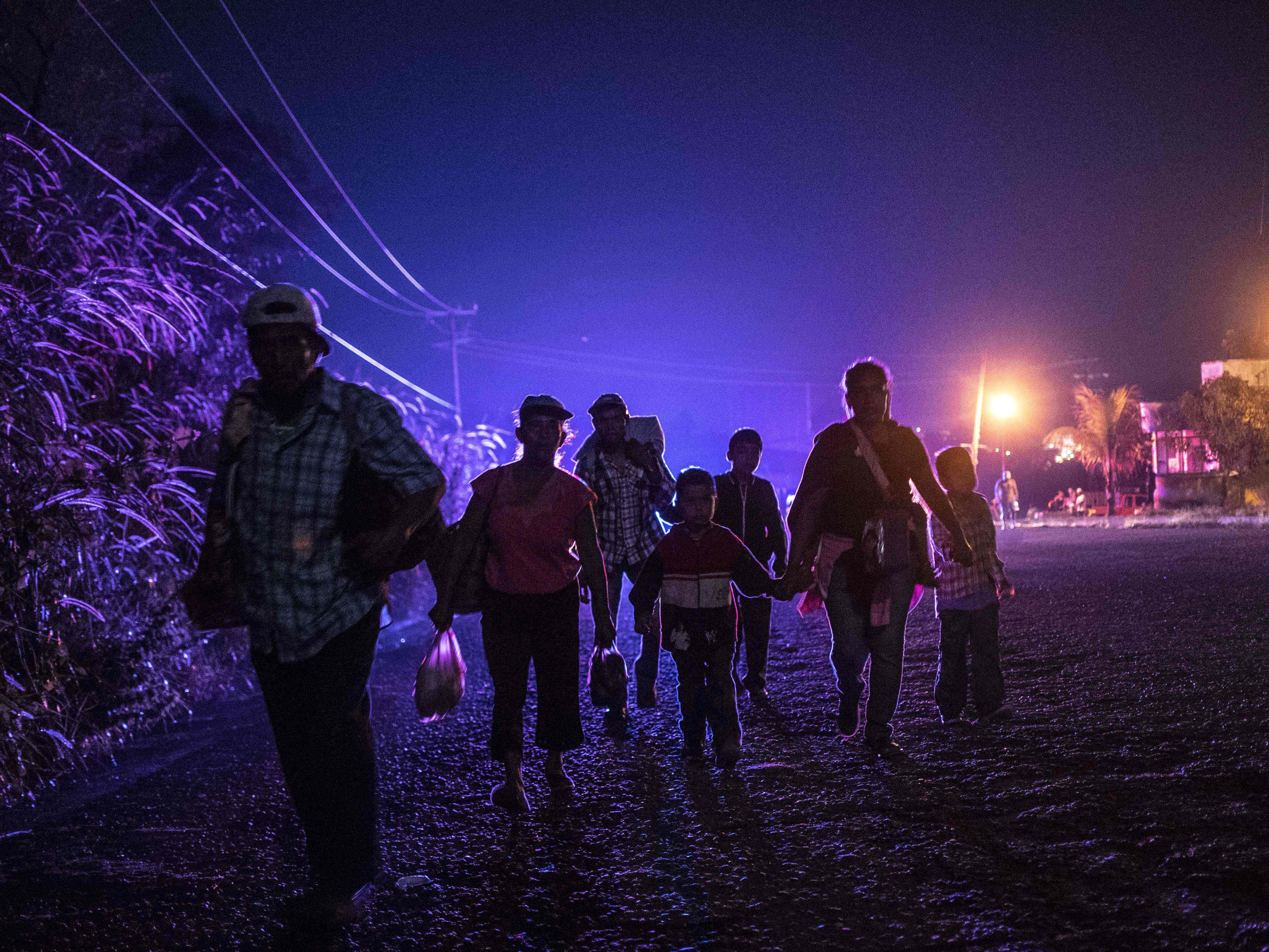 Central  American migrants taking part in a caravan heading to the U.S., walk in Huixtla, Chiapas state, Mexico, on Oct. 24, 2018.