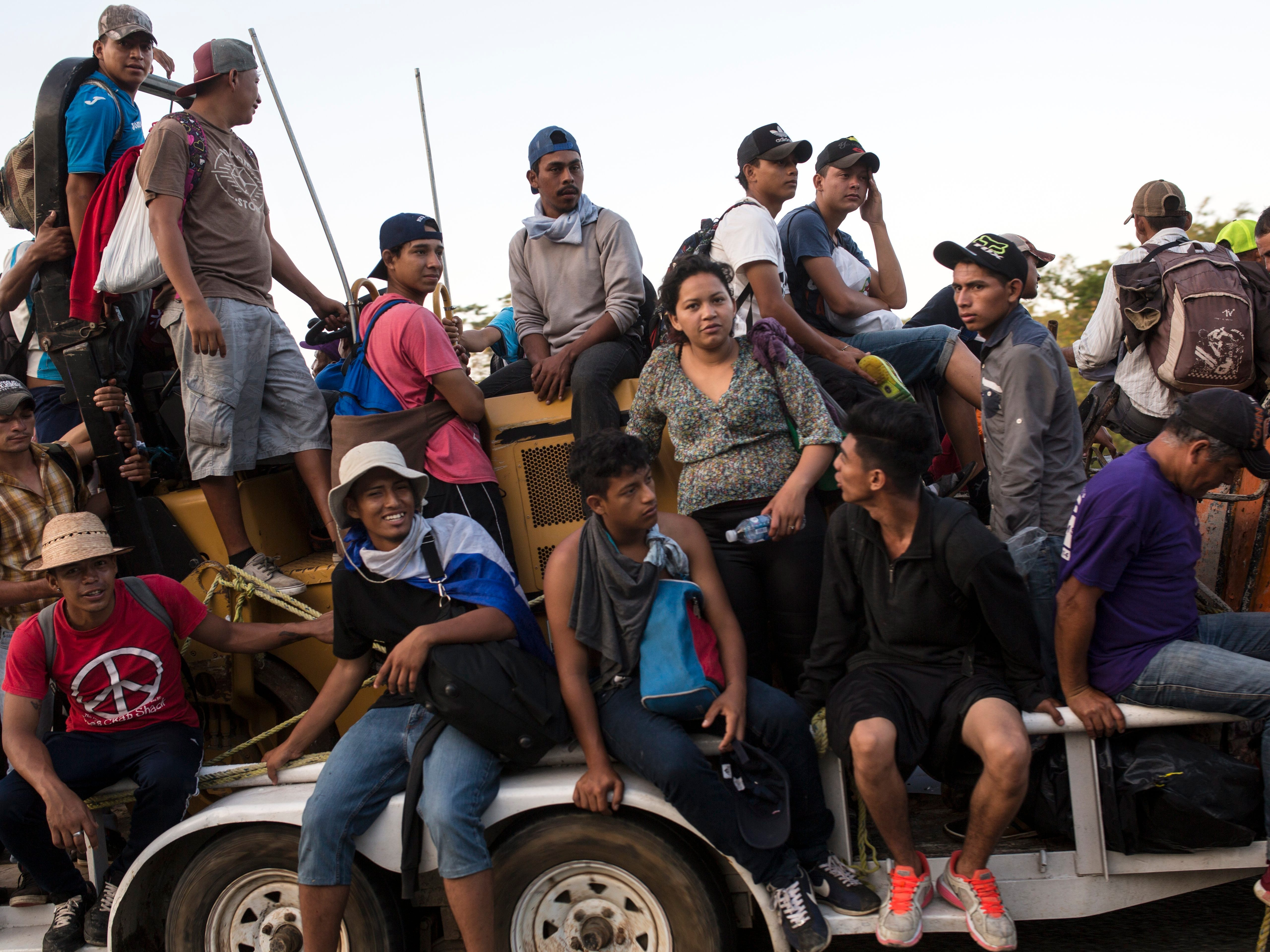Central American migrants traveling with a caravan to the U.S. crowd onto a tractor as they make their way to Mapastepec, Mexico, Wednesday, Oct. 24, 2018. Thousands of Central American migrants renewed their hoped-for march to the United States on Wednesday, setting out before dawn with plans to travel another 45 miles of the more than 1,000 miles that still lie before them.