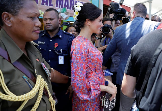 The heat and large crowd forced Meghan, Duchess of Sussex, to cut short her visit to Suva market Wednesday.