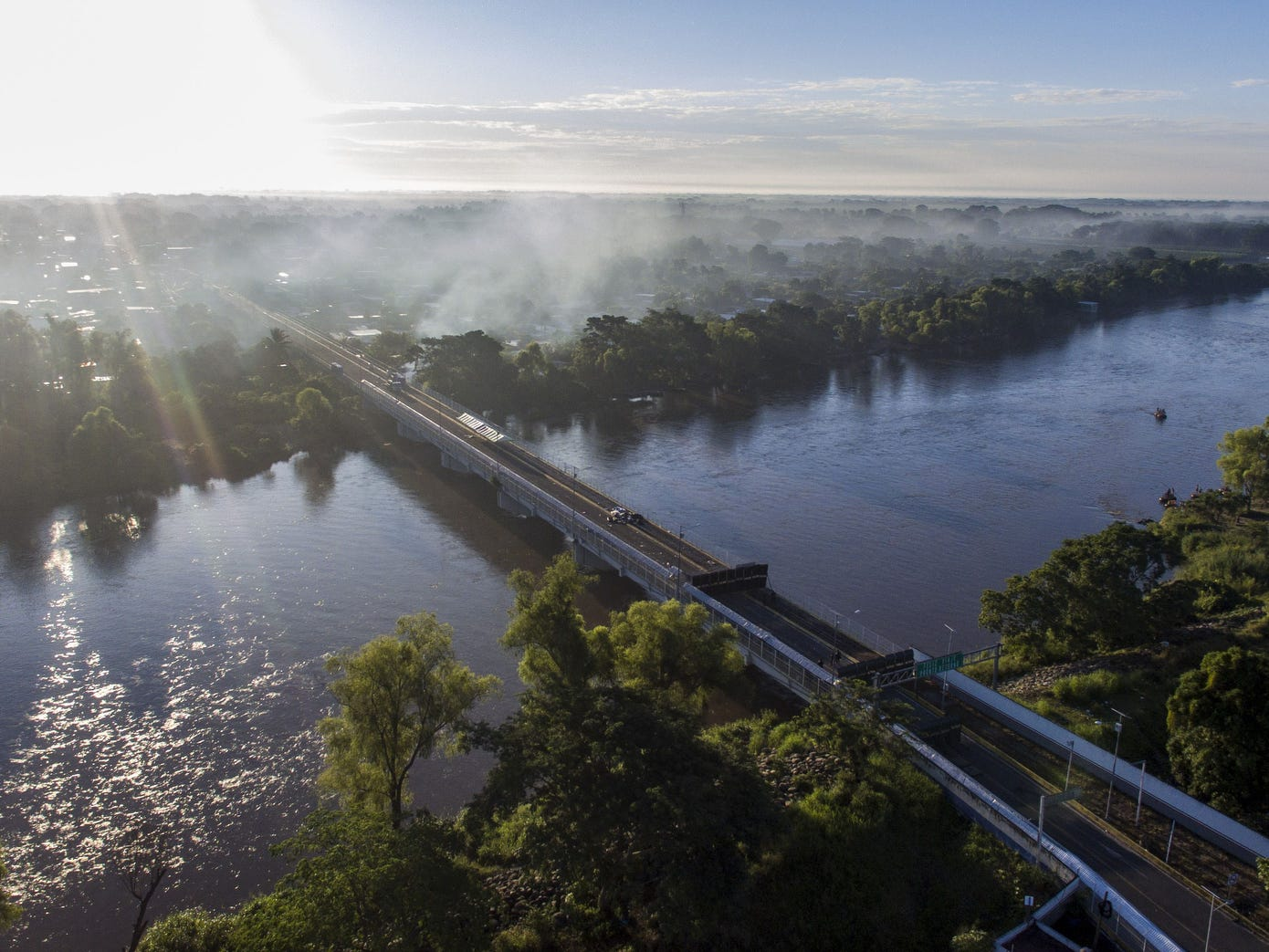 Aerial view of the Guatemala-Mexico international bridge in Ciudad Hidalgo, Chiapas state, Mexico, on Tuesday.  The bridge remains empty a day after a caravan of Honduran migrants heading to the U.S. crossed it. The United Nations said more than 7,000 people were now heading toward the U.S., as more migrants joined the original group, including some Central Americans who were already in Mexico.