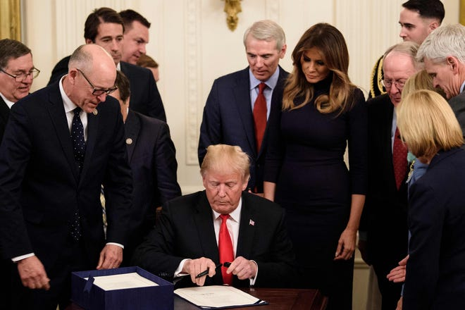 President Donald Trump signs a bill with measures to fight the opioid crisis in the East Room of the White House on Oct. 24, 2018, in Washington, D.C.