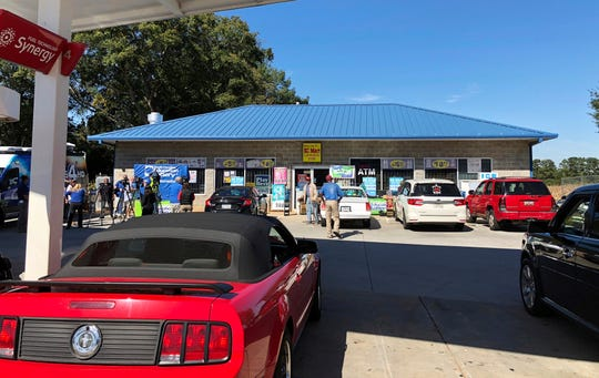 People enter the KC Mart in Simpsonville, S.C., on Oct. 24, 2018, after it was announced the winning Mega Millions lottery ticket was purchased at the store.