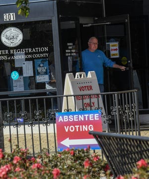 A man walks out of the Anderson County Voter Registration and Elections office at 301 North Main Street in Anderson in October.