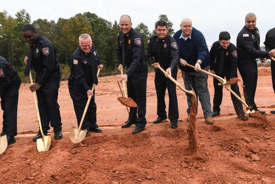 Homeland Park fire station broke ground with officials from Anderson County in a field across South Main Street from their current station in Anderson on Thursday.