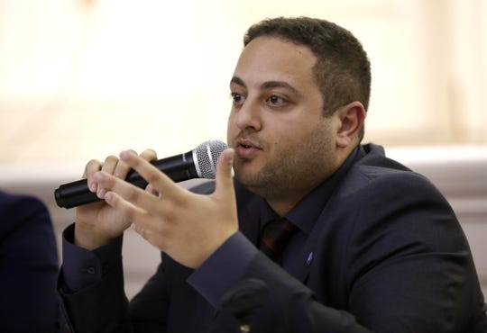 """Red Bank council candidate Hazim Yassin (D) Red Bank Mayor Pasquale """"Pat"""" Menna (D) speaks during municipal candidates forum at River Street Commons on Oct. 23, 2018."""