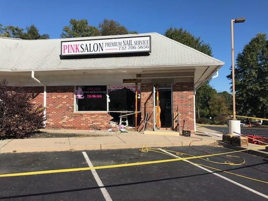 Pink Salon after a car crashed into the front of the building.