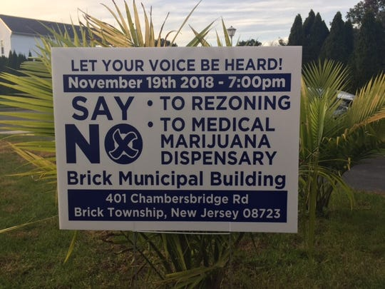 A protest sign for a proposed medical marijuana dispensary is seen near Adamston Road in Brick.