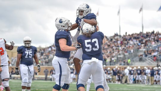 Monmouth players celebrate a touchdown last weekend in a victory over Campbell.