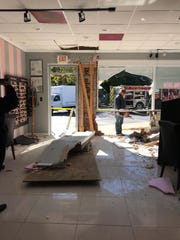 Damage to Pink Salon in Middletown after a car crashed through the building.