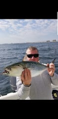 Dennis McConnell, Brick, with a false albacore he landed near Monmouth Beach.