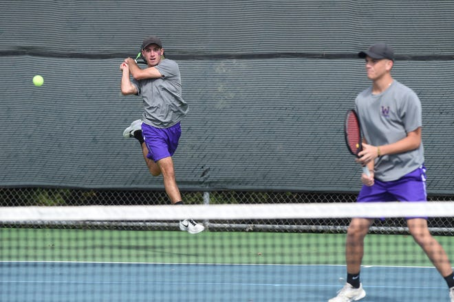 Wylie's Lane Adkins returns a serve behind No. 1 boys doubles partner Davyn Williford during the Region I-5A semifinals at Weeks Park in Wichita Falls on Thursday, Oct. 25, 2018. Adkins and Williford won in three sets as the Bulldogs swept the seven doubles matches.