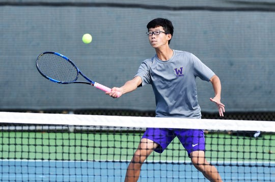 Wylie's Anthony Zhang hits a shot at he net during the mixed doubles match at the Region I-5A semifinals at Weeks Park in Wichita Falls on Thursday, Oct. 25, 2018. Zhang and Mandy Roberson won 6-0, 6-3.