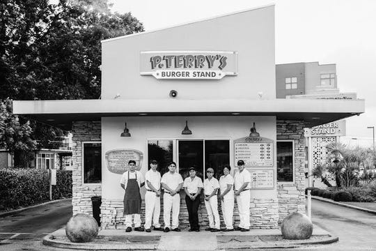 The crew outside the original P. Terry's Burger Stand in the Barton Springs area in south Austin. A former hamburger restaurant, it opened in 2005.