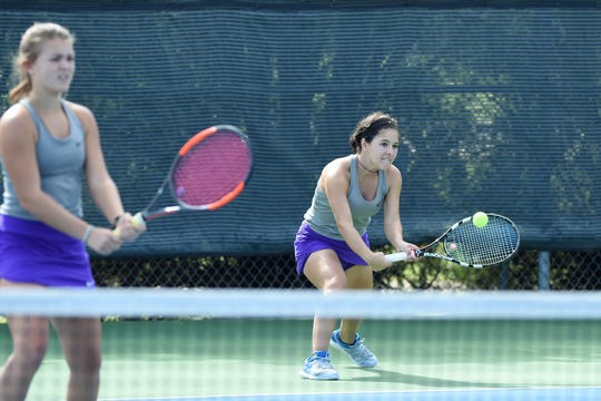 Wylie's Analeah Elias reaches for a shot behind No. 1 girls doubles partner Leighton Alford during the Region I-5A semifnials at Weeks Park in Wichita Falls on Thursday, Oct. 25, 2018. Elias and Alford won 7-6 (8), 7-5.