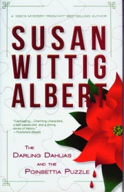 """The Darling Dahlias and the Poinsettia Puzzle"" by Susan Wittig Albert"