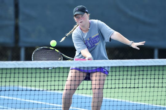 Wylie's Elle Schroeder reaches for a shot during the No. 2 girls doubles match in the Region I-5A semifinals at Weeks Park in Wichita Falls on Thursday, Oct. 25, 2018. Schroeder and Rebecca Yates won 6-3, 6-0.