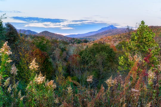 Fall colors frame the view of Grandfather Mountain from Cannon Memorial Hospital in Linville. Although the High Country's higher elevations are mostly bereft of leaves, color can still be found in various lower-elevation locations throughout the region, especially those at 3,500 feet and below.